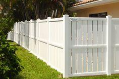white fence backyard