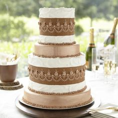 Metallic Bronze Tiered Cake - Add the burlap textured fondant details on this cake easily by using the Wilton Burlap Pattern Roller to imprint pattern. By blending burlap with metallic touches of bronze, it creates a glamorous one-of-a-kind tiered cake perfect for a wedding or anniversary.