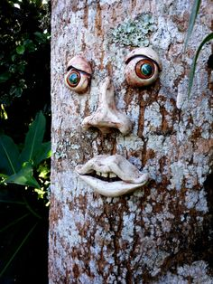 Give a tree a face. Hand sculpted porcelain eyes, nose and mouth with holes on the back to hang on your favorite tree. All you need is three nails, wont