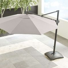 Crate & Barrel 10' Sunbrella ® Silver Round Cantilever Umbrella (1 360 AUD) ❤ liked on Polyvore featuring home, outdoors, patio umbrellas, outdoor patio umbrellas, outdoor umbrella, outdoor telescope, crate and barrel patio umbrella and crate and barrel