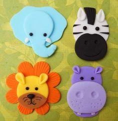 12 JUNGLE ANIMALS. Edible Fondant Cupcake Toppers - Elephant, Zebra, Lion & Hippo. $18.00, via Etsy.