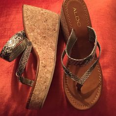 Aldo Wedge Sandal 3.5 inch cork wedge heel, with about 1 inch platform in front.  Snakeskin print straps.  Inside strap lists size as 7 or 37.5No Trades ALDO Shoes Sandals