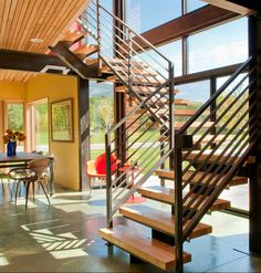 Sunny mid-century #modern #home with gorgeous #stairs and plenty of #windows
