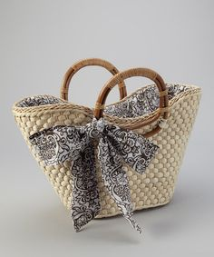 Line a bag with a cute fabric then add a big matching bow on the outside...would like to try this when I learn to sew and make my first purse I'm planning...    Take a look at this Straw Studios Natural & Brown Sash Woven Tote by Straw Studios on #zulily today!