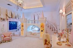 What child in the princess phase wouldn't want a castle for her bedroom? This enchanted room has a staircase leading to a princess balcony and slide. The bed is nestled beneath the castle's arch, and clothes or toys are stored in the pull-out drawers built into the staircase! Yeskel Larvenz pinned this treasure from Sweet Dream Children's Interiors.  Visit our Dream Kids Rooms Pinterest Board to see the rest of our dream room picks, including some unique nurseries!  Photo Source: Sweet Dream…