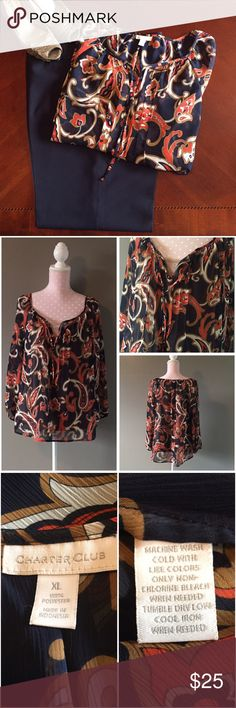 Sheer Navy Blue Print Blouse Swirls & floral & leaf print in orange, cream & taupe on a sheer navy blue background. Wide scoop neckline with a dip at the center, ties loosely. Pleated detail at bust. Pairs well with navy, cream and/or brown slacks/skirts. I wore with a skin tone camisole underneath, but could go navy or cream. No snags or flaws in excellent condition. Questions please ask N168*18 Charter Club Tops Blouses