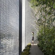 The fifth most popular house on Dezeen is in Hiroshima, Japan, and features a shimmering glass-brick facade.