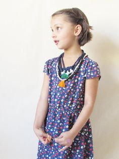 Made from Knit Fabric with a break away plastic closure. These are great for kids. No beads, no metal, no toxic materials. This is a great