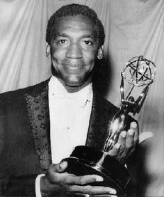 "Bill Cosby, co-star of the ""I Spy"" television series, holds the Emmy Award he received at the annual ceremonies of the Television Academy of Arts and Sciences in New York in May 1966. Cosby became the first African American ever to win an Emmy for a leading role in a television series."