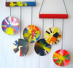 If you have older kids, this spin art mobile is a great project for them to make for the new baby. #baby #nursery #mobile