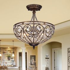 The semi-flush Warehouse of Tiffany Drake Modern Roman Chandelier features an ornate bowl frame in bronze finish that is threaded with clear. Flush Mount Chandelier, Flush Mount Lighting, Chandelier Lighting, Bronze Chandelier, Baccarat Chandelier, Capiz Chandelier, Tiffany Chandelier, Wheel Chandelier, Luxury Chandelier