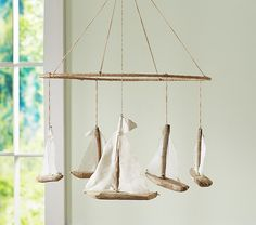 This is a Sailboat Mobile from Pottery Barn Kids. I could probably knock this out with Peter's help no problem!