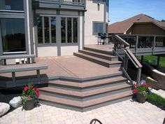 TimberTech Evolutions Pacific Walnut multi level deck with cedar railings and black aluminum pickets in Dublin, Columbus OH