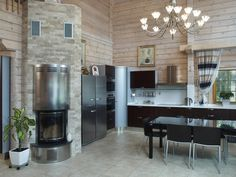 Rustic modern wood and stone kitchen and dining area : by Woody-Holzhaus - Kontio