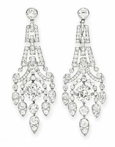 A PAIR OF DIAMOND EAR PENDANTS Each designed as a circular and single-cut diamond articulated plaque of scrolling motif, suspending a tassel set with a larger circular-cut diamond weighing approximately and carats, mounted in platinum Long Diamond Earrings, Diamond Earing, Pearl Stud Earrings, Sterling Silver Earrings Studs, Women's Earrings, Diamond Jewelry, The Bling Ring, Chandelier Earrings, Fine Jewelry