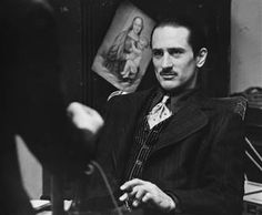 Robert DeNiro as the young Vito Corleone in Godfather 2 #LegendaryStyle