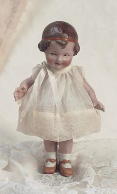 All Bisque Coquette Girl with Orange Ribbon by Gebruder Heubach…