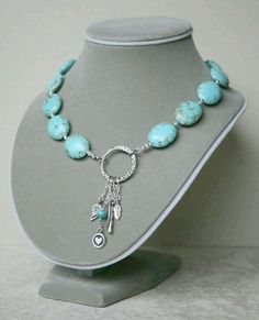 Magnesite Turquoise and Dangling Charm Necklace Oxidized fancy ring embellished with dangling oxidized charms is hung off center from puffed Magnesite Turquoise ovals. This asymmetrical necklace is 16 inches and closes with an oxidized toggle clasp. Wire Jewelry, Jewelry Gifts, Jewelry Necklaces, Jewelry Ideas, Long Necklaces, Collier Turquoise, Turquoise Jewelry, Diy Necklace, Necklace Designs