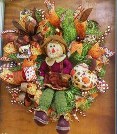 Check out this item in my Etsy shop https://www.etsy.com/listing/454297156/primitive-girl-scarecrow-wreath-fall
