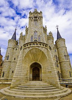 The Episcopal Palace of Astorga, Spain is a building by Catalan architect Antoni Gaudí. It was built between 1889 and 1913. Designed in the Catalan Modernisme style, it is one of only three buildings by Gaudi outside Catalonia.  Although Gaudi began oversight of its building, others completed it.  A wide angle view of Gaudí by SBA73
