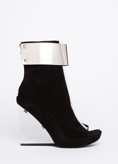 """Get shackled with this ultra-forward wedge by Jeffrey Campbell. Features metal detail at wedge and ankle with see-through design at front. 3.5"""" platform."""