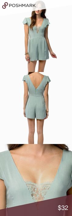 "Tobi ""go deep"" sage lace romper size small NWT Gorgeous light green romper with glitter sleeves, a deep back and front with lace detailing in the front. Zips up the back Tobi Pants Jumpsuits & Rompers"