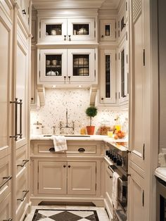 Great floor design and use of to the ceiling cabinets in a great beige color