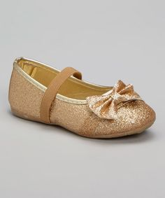 This Gold Glitter Bow Flat by Ositos Shoes is perfect! #zulilyfinds