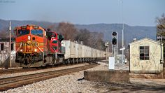 NS 251 with a colorful pair including a BNSF and Ferromex unit as they fly through the town of Rockwood, TN at track speed