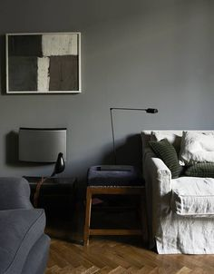 This comforting corner of architect Marzio Cavanna's Milan living room uses five shades of gray...