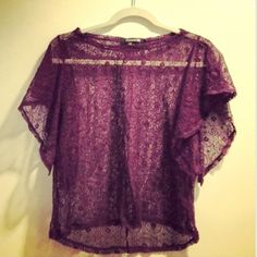 Purple lace top Dark purple lace top from Forever 21. The bottom has a hi-lo hem and the sleeves are short and tacked. Perfect over a tank. In excellent condition! Forever 21 Tops Tees - Short Sleeve