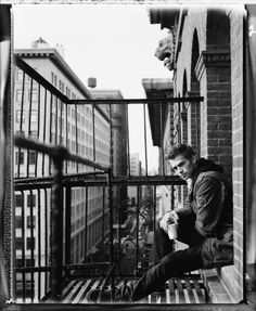 Up on a fire escape with great architecture in the background... Where can I find this in TH?