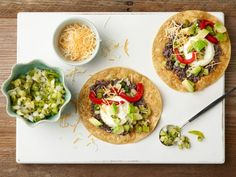 Inspired by huevos rancheros, these tostadas are especially good when served with salsa verde, but you can try them with your favorite red salsa too.