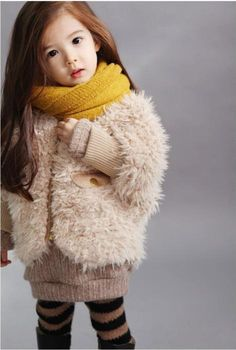 How CUTE!! I want her scarf, coat, and the leggings!
