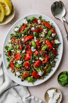 This easy roasted pepper salad recipe is made with farro, goat cheese, arugula, basil, and a simple white wine + lemon vinaigrette dressing. It can be enjoyed warm or cold, and served as either an entree style salad or as a side dish.