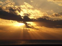 Sunrise over the waters of Cozumel, Mexico taken by me...glory to God!