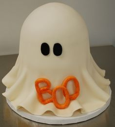 "Ghost Cake - This is the very first fondant cake I made.  It is three 6"" rounds stacked with a half ball stacked on top of that."