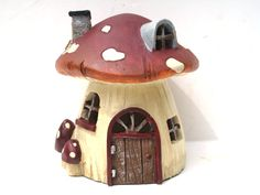 Gnome Home Ceramic Fairy House  This Fairy House comes with a miniature key and a bottle of fairy dust with a fairy card attached to stir the imagination!  Children can see Fairies much easier than we adults and they will find this Miniature Fairy House to be magical. It will spark their imaginations especially when the Fairies come to visit!   Size: approx. 4 1/2 high by 4 wide  A great gift for a child to expand their imagination and enjoy magical moments!   Every garden needs a Fairy…