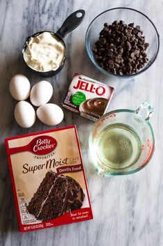 Overhead photo of the ingredients to make a chocolate nothing bundt cake including cake mix eggs oil chocolate pudding mix sour cream and a bowl of chocolate chips. The post Nothing Bundt Cake Copycat appeared first on Dessert Park. Chocolate Cake Mixes, Chocolate Recipes, Chocolate Chips, Chocolate Covered, Chocolate Chip Pudding Cake Recipe, Cake With Pudding Mix, Chocolate Chip Bunt Cake, Chocolate Sour Cream Cake, Triple Chocolate Bundt Cake Recipe