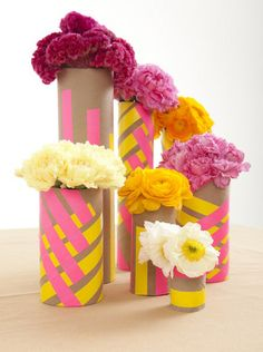 neon and neutral floral centerpiece from cardboard tubes and washi tape