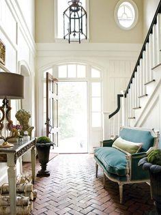 love the beautiful brick herringbone floor design..