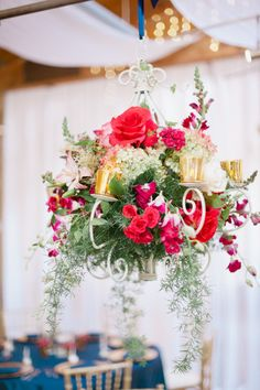 This flower & candle chandelier is such a unique decor touch. #weddings