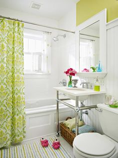 Use a colorful shower curtain or rug to brighten up a white bathroom. More bathroom design ideas: http://www.bhg.com/bathroom/small/small-bathroom-decorating-ideas/?socsrc=bhgpin091713greenshowercurtain#page=9