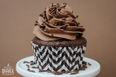 Triple Chocolate Cupcakes - moist chocolate cake, creamy chocolate buttercream, and a truffle hide in side! @MakeBakeCelebrate