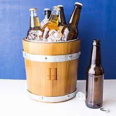 Rustic barrel design ice bucket personalized with a single initial makes an appealing wine or beer bottle chiller. Crafted from fir wood bound by galvanized metal staves with galvanized metal bucket insert Wooden Cooler, Girlfriend Anniversary Gifts, Wedding Favor Table, Wedding Favors, Wine And Beer, Romantic Gifts, Wine Gifts, Groomsman Gifts