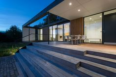 A modern family home in Demnark with open space design and neutral color palette.