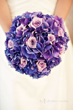 Hydrangea & rose bouquet. I might use less dramatic hydrangeas, though. Like a lighter blue/violet.