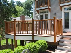Cedar decking in Wellsley Ma, we pressure washed and applyed wood sealer finished off with white painted trim.