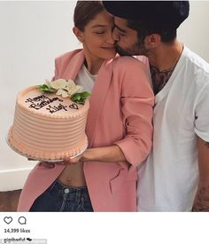 Loved up: The 22-year-old was given a cake and a kiss by her boyfriend Zayn Malik...