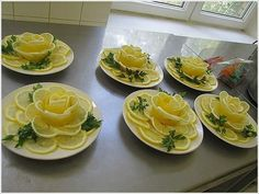 These Lemon Flowers would be lovely on a cold seafood appetizer plate.Lemon Roses for Ladies TeaTop a whole lemon cake in lemon rosesThese Lemon Flowers will be Great to Garnish Your Food. Bridal shower idea for a tea party. Lemon Flowers, Fruit Flowers, Edible Flowers, Fruit And Vegetable Carving, Food Carving, Food Garnishes, Garnishing Ideas, Food Displays, Food Decoration